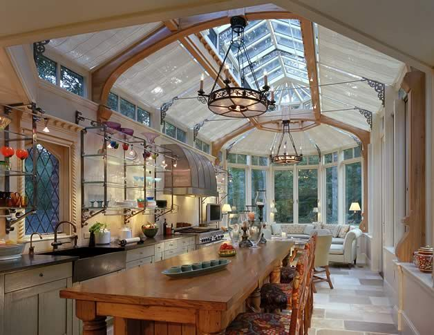 The center island is large and great for food prep, as well as entertaining, while the host prepares the meal. It is made of antique, reclaimed chestnut and has refrigeration drawers built into it. Barnes Vanze Architects - Traditional Architecture, Renovations and Additions