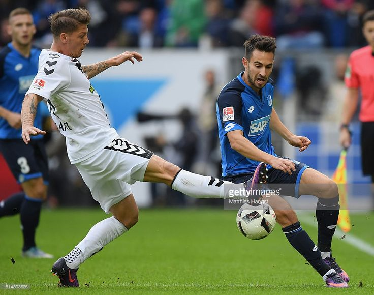 Lukas Rupp of Hoffenheim is challenged by Mike Frantz of Freiburg during the Bundesliga match between TSG 1899 Hoffenheim and SC Freiburg at Wirsol Rhein-Neckar-Arena on October 15, 2016 in Sinsheim, Germany.
