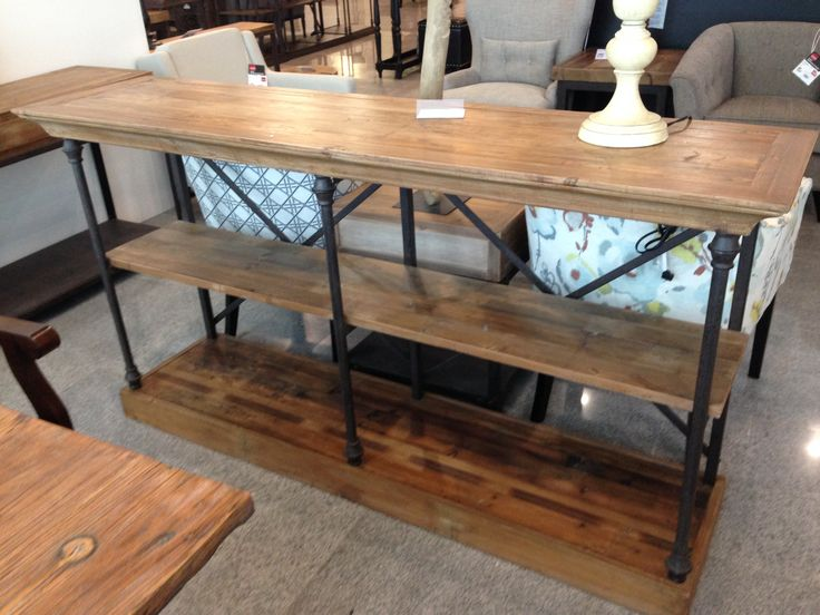 Reclaimed old pine and steel sofa table/ library table. would be great in a kitchen for extra storage. www.nestinghabits.ca