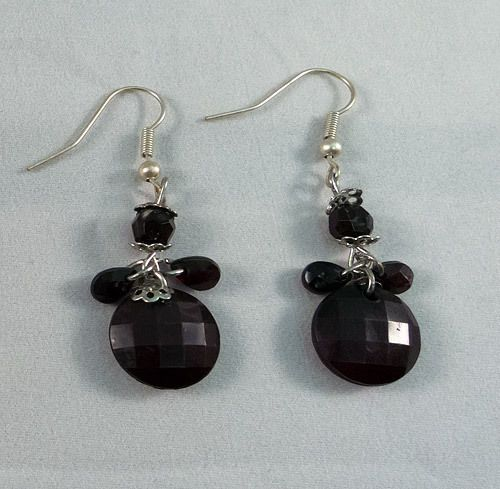 These are beautiful earrings made of black beads. They measure at 3.5 cm.