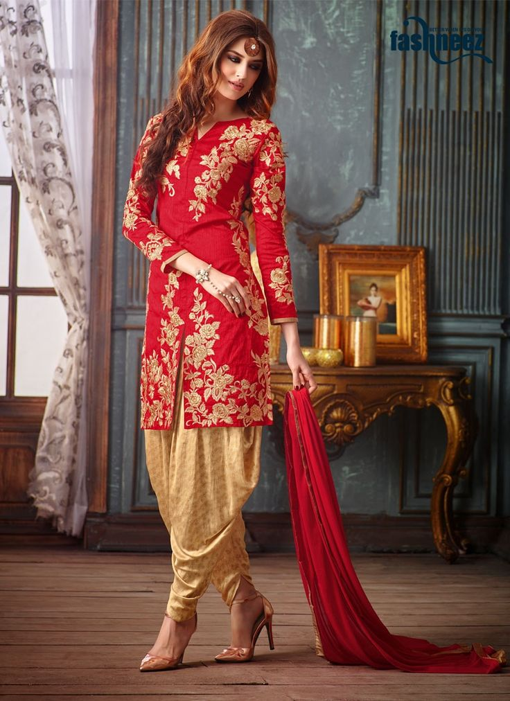 Attract compliments by this red banarasi silk designer patila salwar suit. The amazing attire creates a dramatic canvas with fantastic embroidered and patch border work. Comes with matching bottom and...