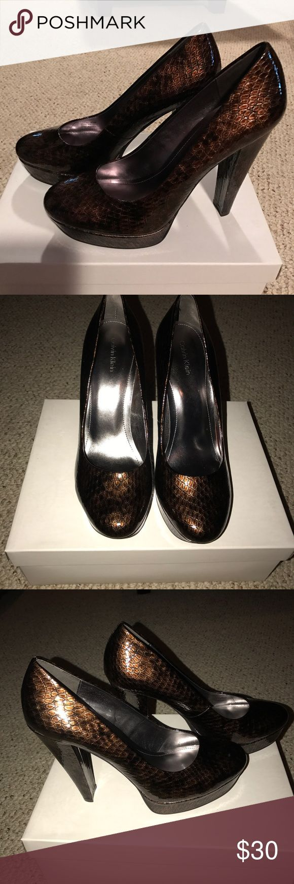 Size 8.5 Calvin Klein bronze shoes Size 8.5 Calvin Klein heels. Worn maybe twice but my feet grew to a 9 after my pregnancy. So cute, I wish they fit! Calvin Klein Shoes Heels