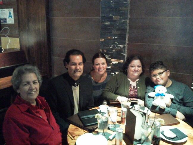 My sister Carmen, myself, niece Tatiana, friend Chely, and grand-nephew D'Angelo. Great Asian food, loved their vegan kung pao chicken option! -having lunch at Wokcano Downtown