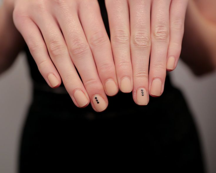 Matte nude nail art with black studs from the Houghton Spring 2015 show // 51 Spring Nail Art Ideas to Rock Off the Runway