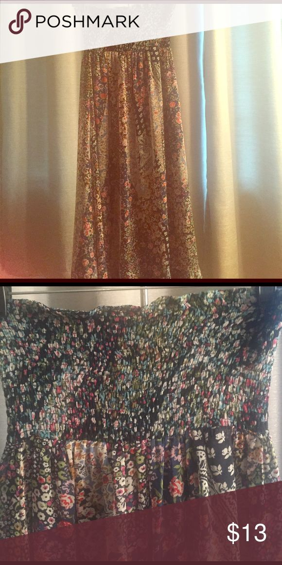 Strapless Smocked Top Maxi This is a super cute strapless floral print maxi that looks great paired with a camel colored wedge. Perfect for spring! Dresses Maxi