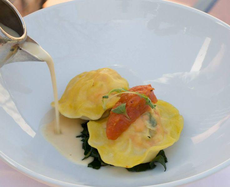 Prawn and Salmon ravioli (made fresh in our kitchen!) with lemongrass veloute and tomato chutney http://tenbompas-restaurant.co.za/