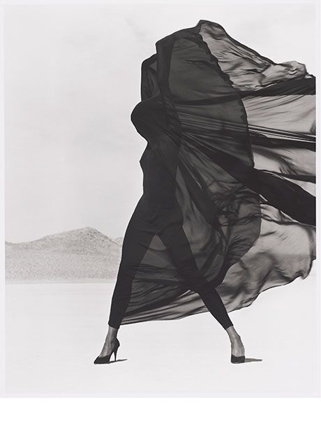 """10 Iconic Fashion Photos That Redefine """"Power Pose"""" #refinery29  http://www.refinery29.com/herb-ritts-fashion-photography#slide-5  """"Versace Veiled Dress, El Mirage"""" (1990)"""