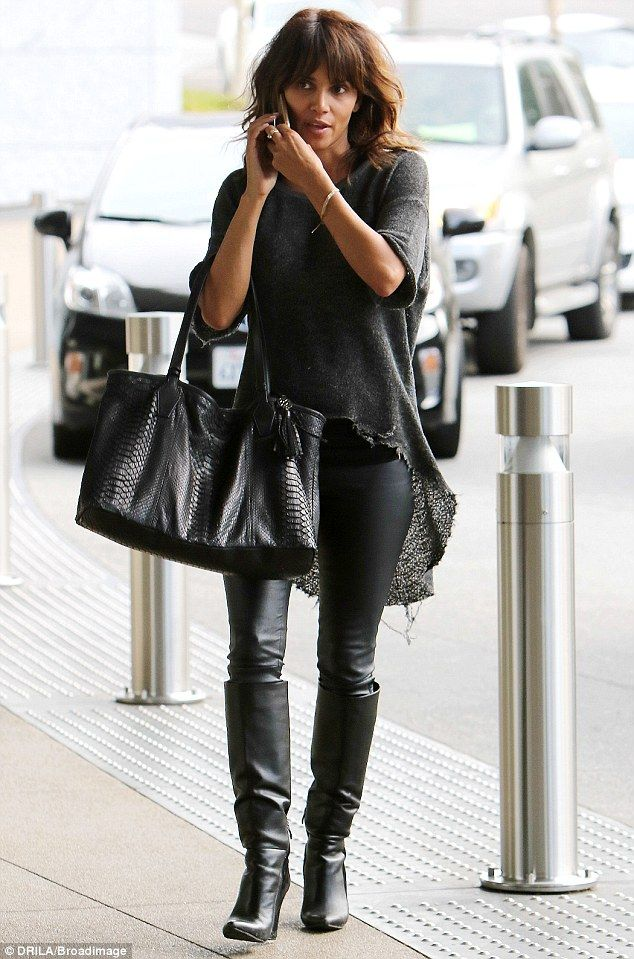 Meow: Halle Berry looked like her Catwoman character as she wore leather slacks and boots in LA on Thursday