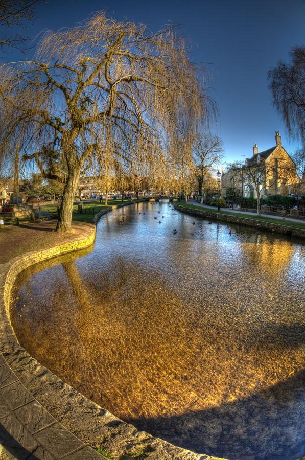 "Bourton-on-the-Water, Gloucestershire, England. We were there when the World Cup was playing and the local football club played ""water"" soccer in the river."