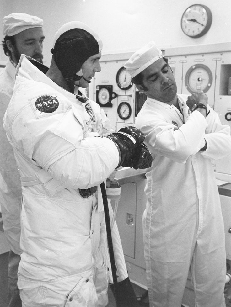 Apollo 16 Ken Mattingly checks his wristwatch during suit-up for launch. 16 April 1972.
