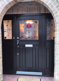 This simple door and side panels looks stunning with Art Nouveau style glazing with complimenting door furniture in an antique finish.