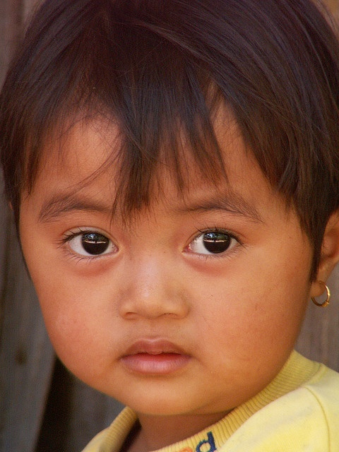 Indonesian cutie. Her big eyes and dainty little mouth remind me of my great-niece when she was that age.