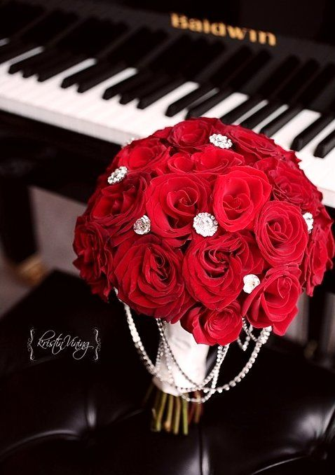 Beautiful red rose bouquet. My bridesmaids would have just one long stem rose with one beaded gemstone. Too perfect.