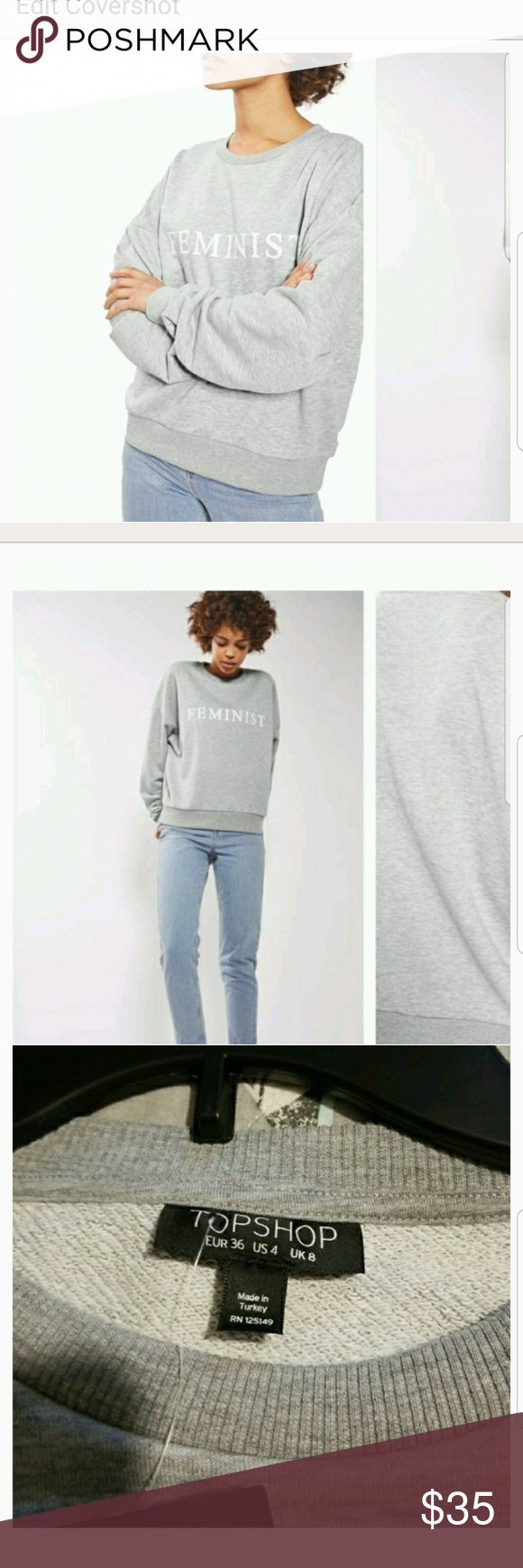 Top shop feminist sweatshirt oversized!! This is an oversized fit!! More like a large....brand new with tags....purchased from nordstroms last season and was sold out very quickly...color is gray with white lettering..cotton /poly mix....23.5 inches across chest and approx 24 inches long...looks just like the stock photo..its labeled size 4 but fits much bigger!! top shop Tops Sweatshirts & Hoodies