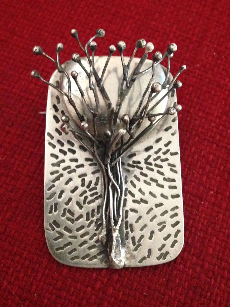 Silver tree and moon brooch made from silver sheet and silver wire.