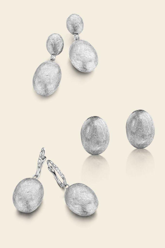 Dancing in the rain. Gioielli in oro bianco 18kt, diamanti e pietra di luna. - NANIS
