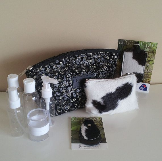 Travel Gift Set with Keychain, luggage tag, cosmetic bag and purse.