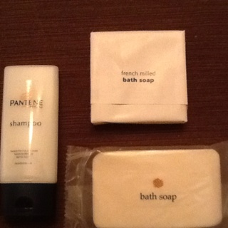 Donate mini bath products from hotels to homeless shelters, they need single use products.