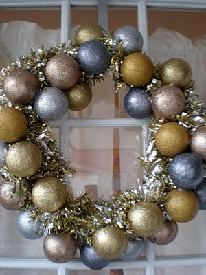 Ornament wreath, but add tinsel from the dollar store, too!