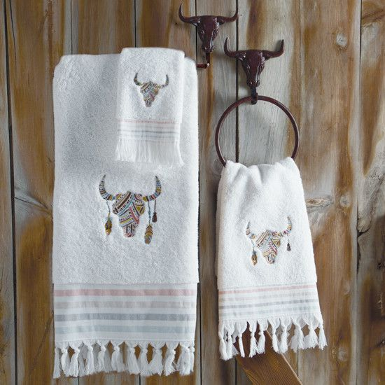Navajo Spirit Longhorn Towels- These soft fringed terry towels have a mosaic embroidered cow skull and striped linen edges in pink, blue, tan and green.