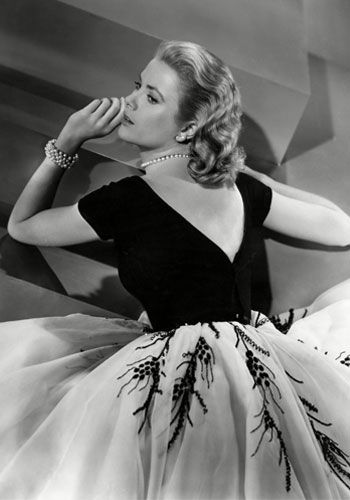 Another perfect image for me!!! Awesome dress, angles of stairs match v neck on back, arms balance the dress, hair is great. Tone of b,w, & gray are awesome. Grace Kelly from Rear Window w Jimmy Stewart.