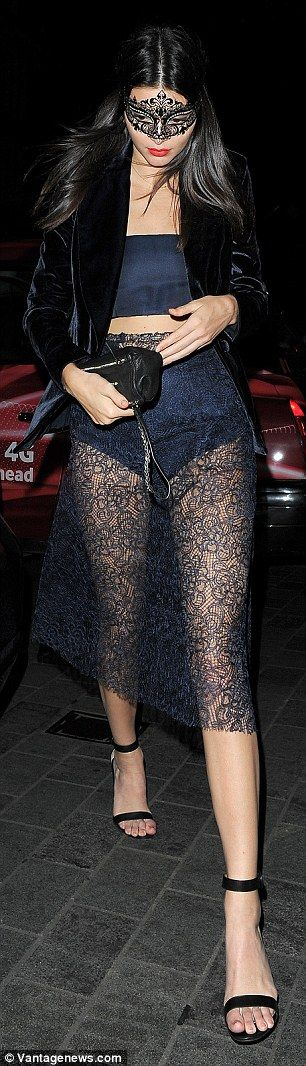 Bottom's up: The fashion muse's pert behind was visible through her navy blue lace midi sk...