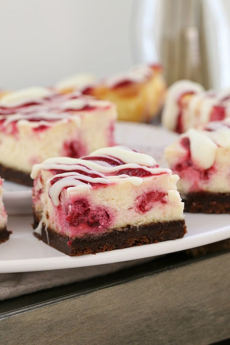 White Chocolate & Raspberry Cheesecake Slice White Chocolate & Raspberry Cheesecake Slice Indulge in the most deliciously simple White Chocolate & Raspberry Cheesecake Slice! With a chocolate biscuit base, creamy white chocolate filling with tangy raspberries, all topped off with a berry coulis… talk about YUM! #raspberry #cheesecake #slice #baked #bars #white #chocolate #easy #recipe #thermomix #conventional #best #dessert