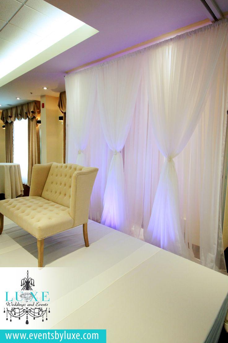 White wedding backdrop, white wedding backdrop with purple uplighting, purple uplighting, elegant wedding backdrop, simple wedding backdrop