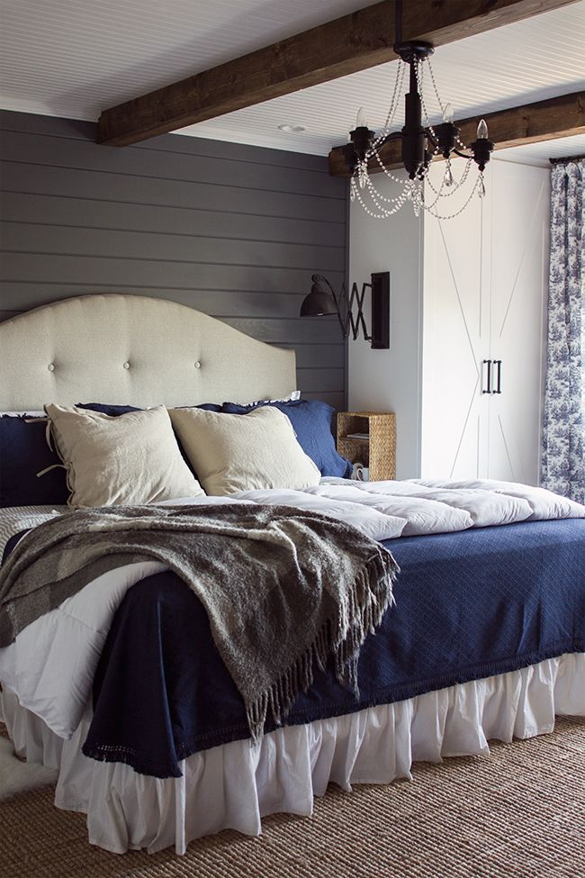 Cozy master bedroom - love the gray planked walls, beams on the ceiling, built in cabinets instead of bed side tables and more eclecticallyvintage.com