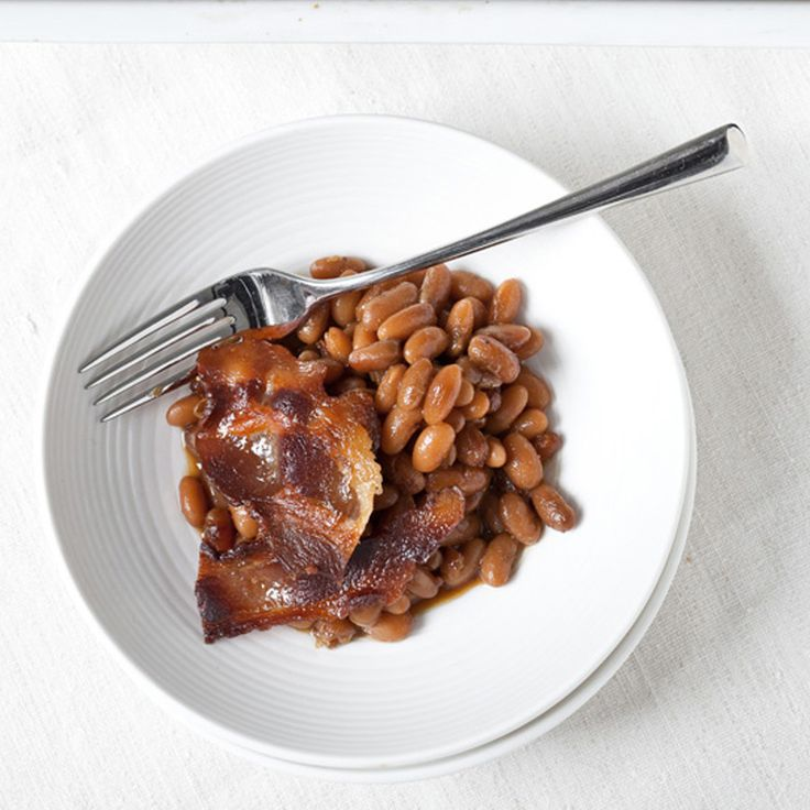 For a zippy version of a New England classic, Laurence Jossel bakes buttery Rancho Gordo Yellow Eye beans in a tangy-hot mixture of apple cider vinega...