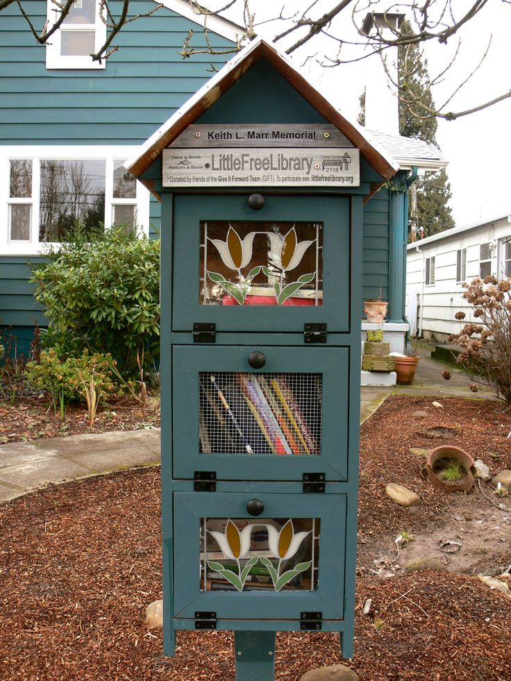 A Little Free Library in Portland, OR, photographed by Rioter Jill Guccini.... I love my city!