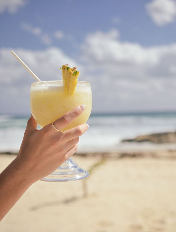 Drink cocktails on the beach. Just add the experience to your Patchwork Honeymoon Fund and ask wedding guests to chip in.