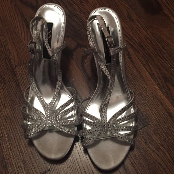 Silver dress shoes three inch heel Amazing Nina New York silver dressy shoes. Strap with clear rhinestones. Size 9 Shoes