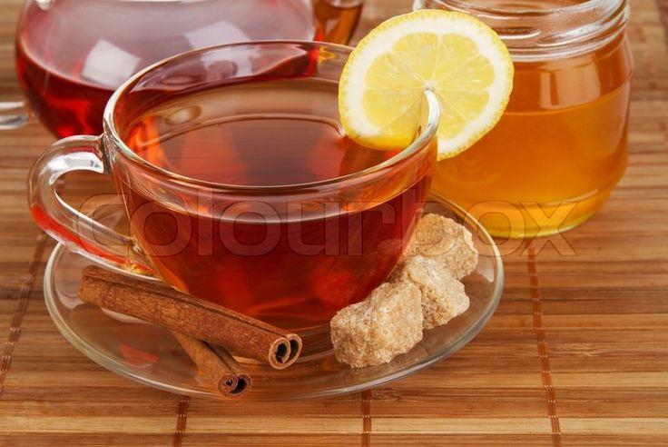 Stock image of 'Tea with honey, lemon and cinnamon'