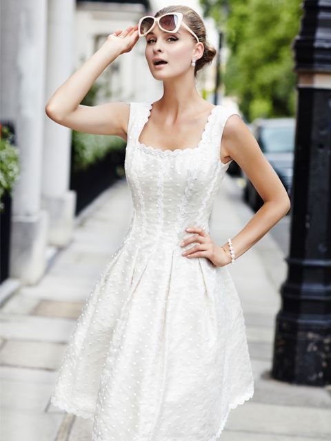 This stunning Ian Stuart dress is beautifully designed with a silk dupion and silk spot organza fabric in a platinum white shade of colour. Product code ISL480. View more Mother of the Bride / Groom dresses from our Ian Stuart collection at: http://www.baroqueboutique.co.uk/mother-of-the-bride-south-wales/ Photographs courtesy of: http://www.ianstuart-london.com/