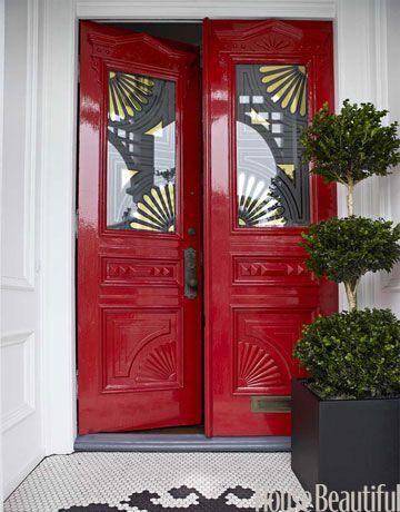 Front doors in Benjamin Moore Heritage Red. Design: Ken Fulk