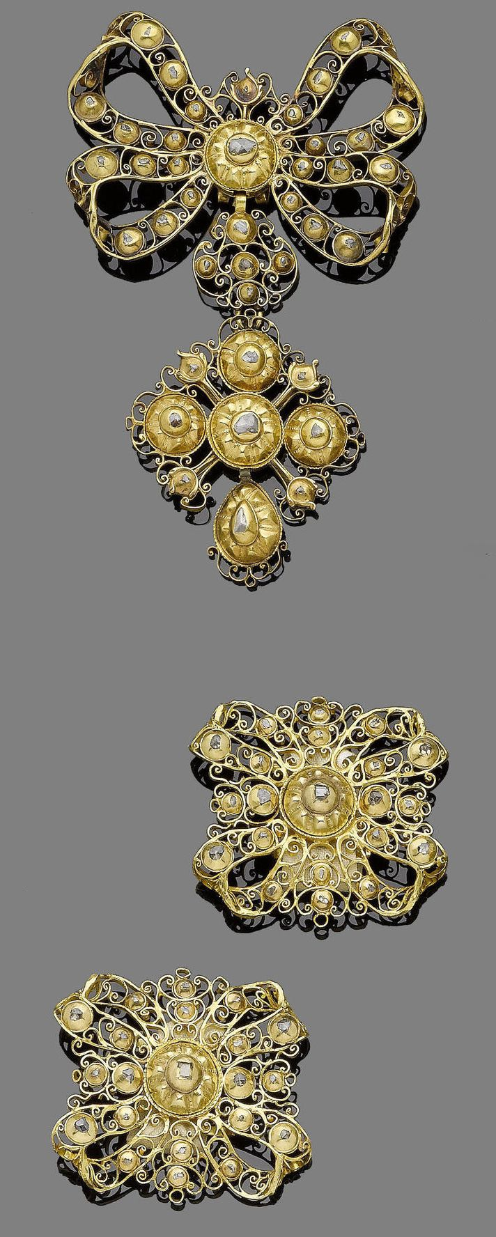 An 18th century gold and diamond suite, probably Portuguese  The laça bodice ornament designed as an openwork bow, suspending a similarly decorated cross pendant, collet-set throughout with rose and table-cut diamonds in closed-back settings, accompanied by a pair of similarly set dress ornaments designed as stylised bows, lengths: bodice 9.5cm, dress ornaments 4.3cm and 4.5cm