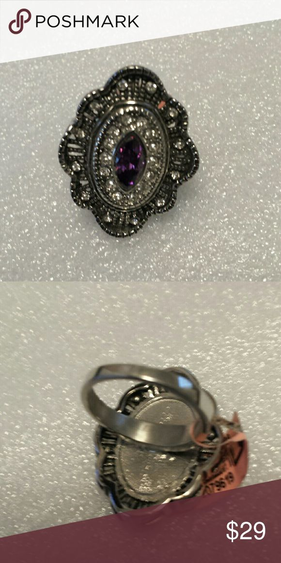 Simulated purple or champagne  diamond Beautiful simulated purple diamond ring in stainless steel champagne diamond is a size 6 purple diamonds size 9 Jewelry Rings