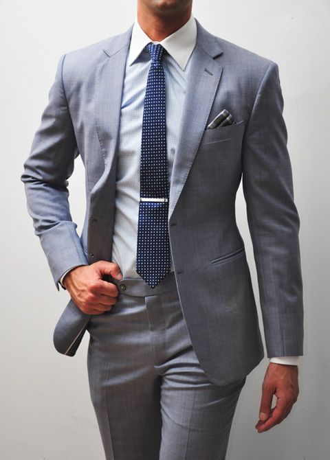 Gray suit + polka dot navy tie + plaid pocket square