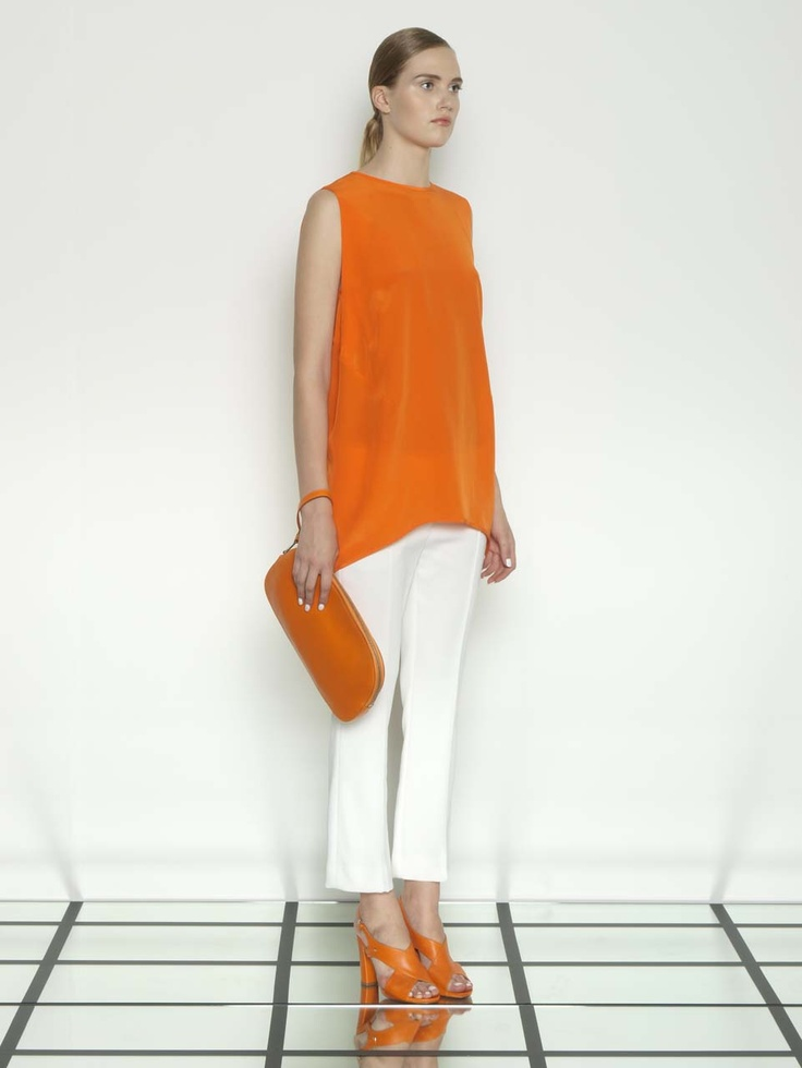 Sportmax 2013 I want that orange clutch to have a round hole at one end big enough to put her hand through