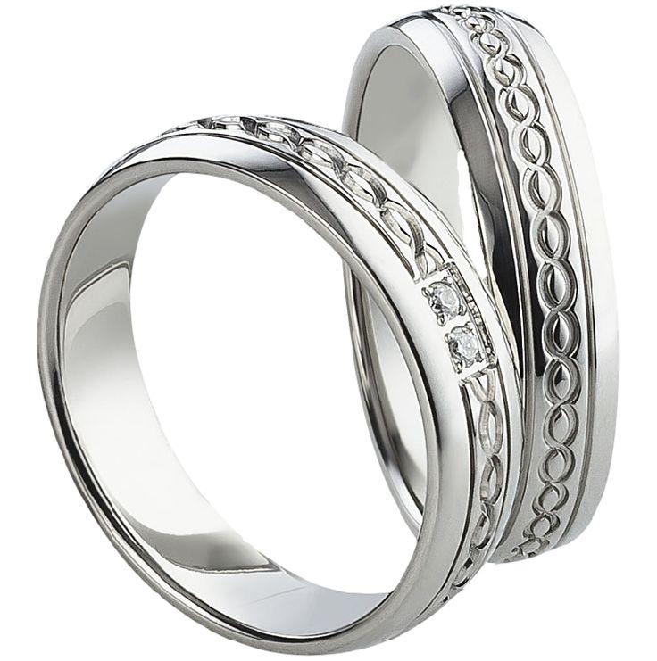 Snubní prsteny T1016  Snubní prsteny vyrobeny z chirurgické oceli s lesklou povrchovou úpravou. Dámská varianta je doplněna zirkony. #aiola #wedding #rings #engagement #svatba #snubni #prsteny #chirurgicka #ocel