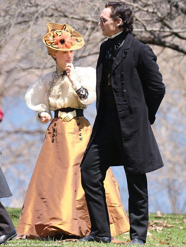 Summer stroll: The 24-year-old star and Tom Hiddleston take a stroll during the period film shoot