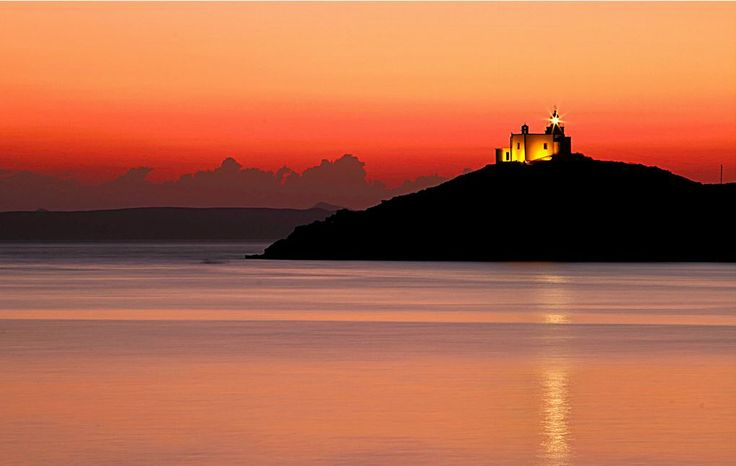 Amazing Sunset with the Lighthouse of the island of Kea