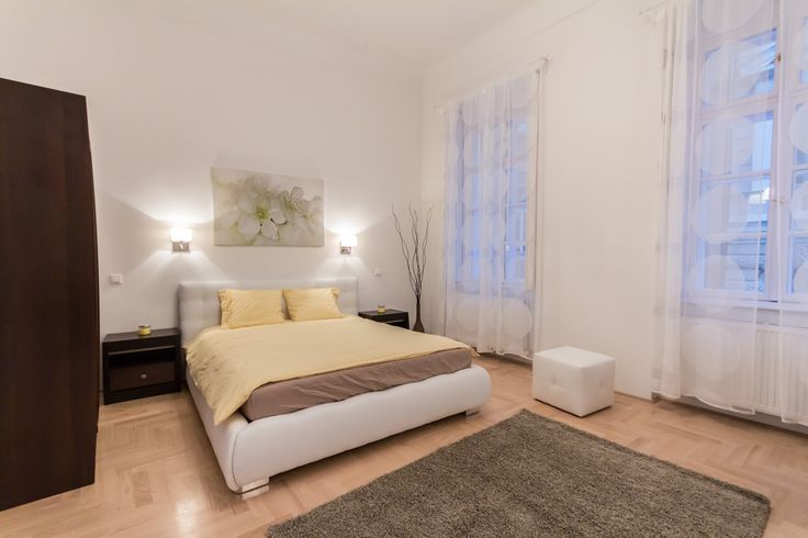 Bright, yellow&white master bedroom / Budapest downtown apartment renovated and furnished by www.towerassistance.com