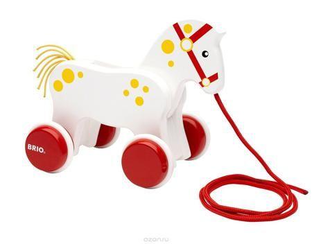 """Brio Игрушка-каталка Лошадка  — 2806р. ------------------------- Игрушка-каталка Brio """"Лошадка"""" непременно понравится вашему малышу, подойдет для игры, как дома, так и на свежем воздухе. Игрушка выполнена из дерева с использованием нетоксичных красок в виде маленькой лошадки. Благодаря текстильному шнурку и четырем колесикам малыш сможет катать игрушку. Во время движения лошадь двигает головой. Игрушка-каталка Brio """"Лошадка"""" развивает пространственное мышление, цветовое восприятие…"""