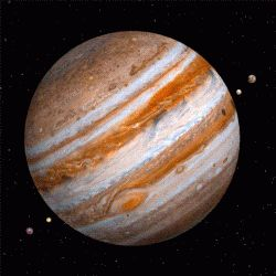 Jupiter is the largest planet in the solar system. It has 67 moons which orbit around it. The spot in the lower left is the Great Red Spot, a giant storm that has existed since the 17th century.