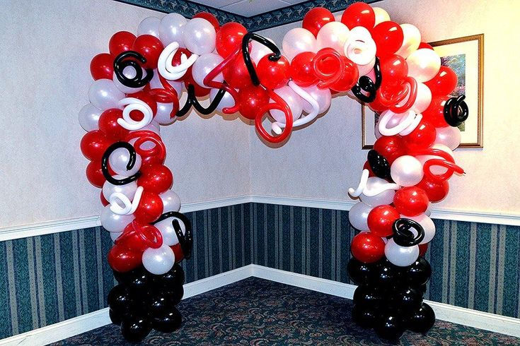 Red White and Black Wedding Arch  #Balloon #arch for wedding and a backdrop for taking pictures.  It would have looked much better if the ceiling would have been taller and the arch was taller, but the customer's wish is the law!  #Boston MA    #Wedding decorations