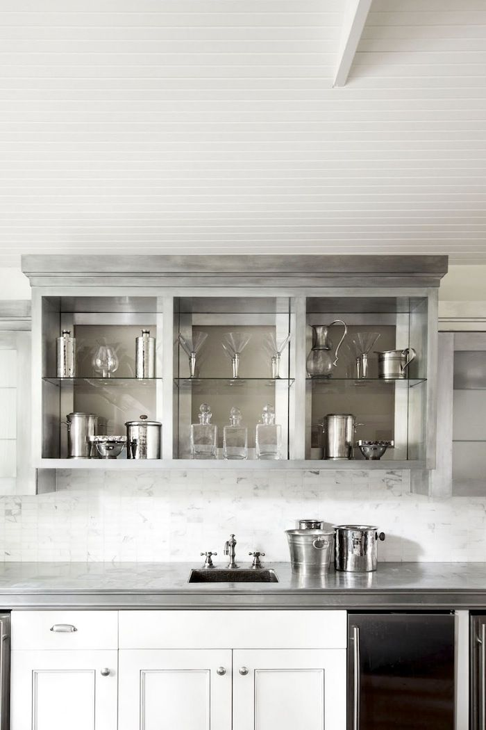 Bar Area With Silver Cabinetry Carrara Backsplash And What Look To Be Zinc Countertops