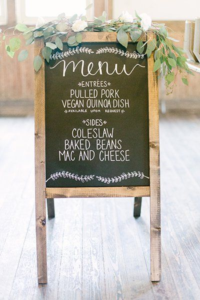 Forgo the price of paper and list the night's fare on a sign for a bit of charm.