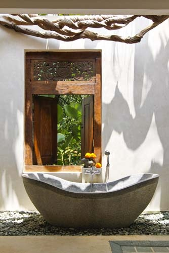I'M ALL IN!!  :)  now that makes a bath special!  what a place to soak.  Ubud, Bali - Beautiful hand carved teak door & frame